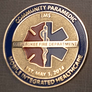 MFD's Mobile Integrated Healthcare Program awarded coins to iCare for partnership in reducing emergency room overuse.